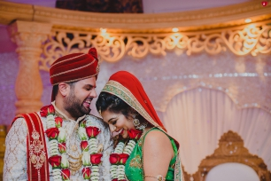 A happy couple after their hindu wedding ceremony at the Last Drop Village Hotel Bolton